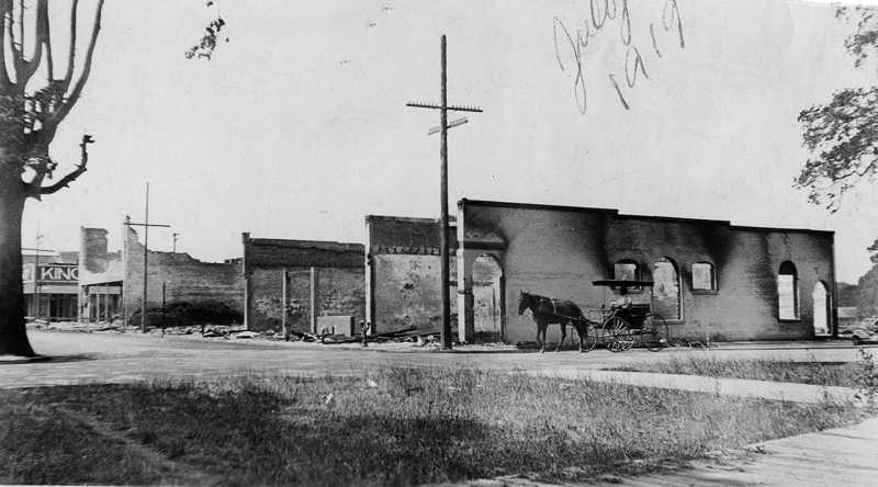 by: COURTESY PHOTO: FOREST GROVE FIRE & RESCUE - A horse and buggy stand next to whats left of the Forest Grove City Library, then located on the northeast corner of College Way and 21st Avenue. The librarys far east wall (nearest the buggy) survived and is now part of Pacific Universitys Rogers Building, which retains the outlines of the original windows.