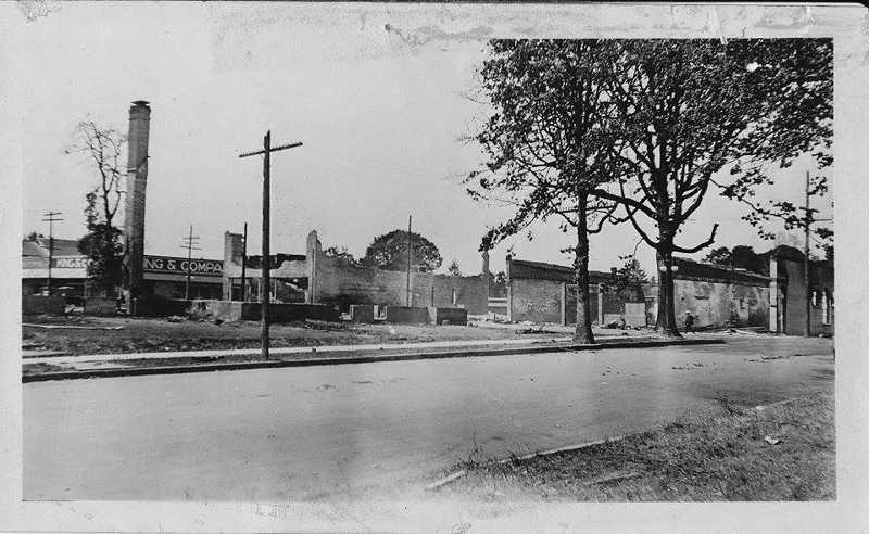 by: COURTESY PHOTO: FRIENDS OF HISTORIC FOREST GROVE - Before they became smoking ruins, these buildings along what is now 21st Avenue (here looking east toward Pacific Universitys Marsh Hall from Main Street) included the city library at the far end on the left and the Congregational Church on the right. After the 1919 fire, the only part of the church left standing was its tall, thin chimney.
