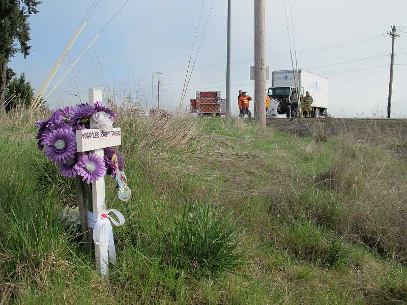 by: NEWS-TIMES PHOTO: JILL REHKOPF SMITH - Oregon State Police interview truck driver Cody Jensen and study Mondays crash site not far from a roadside memorial for 16-year-old Kaylee Tawzer, who died in a remarkably similar accident in September 2007.