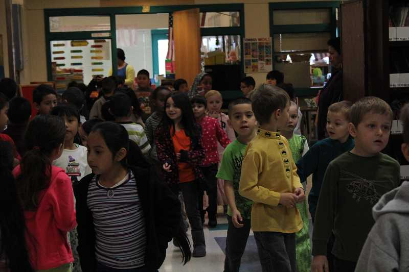 by: LINDSAY KEEFER - Visitors to Heritage Elementary School got a glimpse of the hectic passing time between kindergarten classrooms.