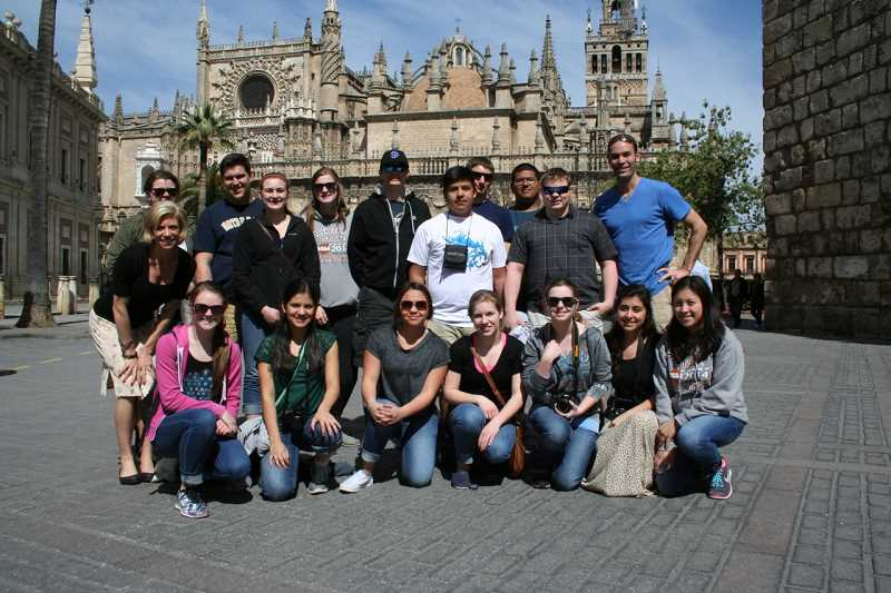 by: SUBMITTED - The entire group visiting Spain from St. Paul stands in front of the third largest cathedral in the world, located in Seville.