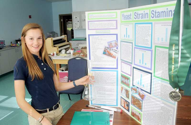 by: SETH GORDON - Best and brightest -- St. Paul Parochial School eighth-grade student Casey Novak displays her entry on yeast strains that won her top honors at a recent microbiology contest.