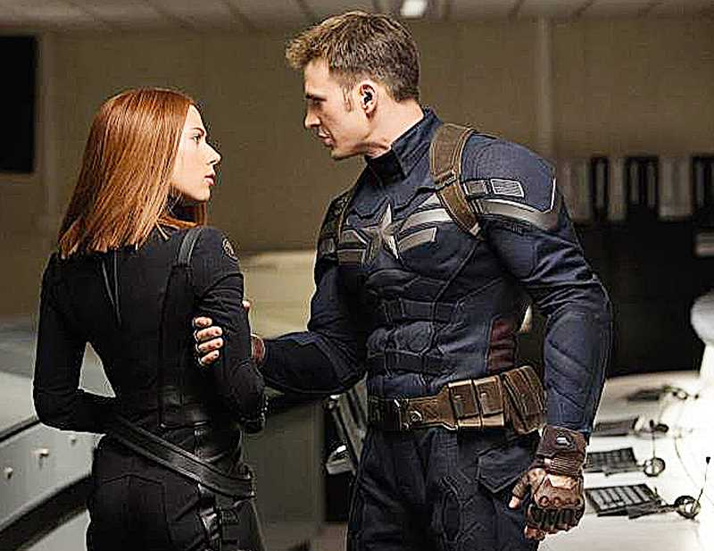 by: SUBMITTED PHOTO - New movie -- Scarlett Johansson and Chris Evans face off during a rescue mission in the latest Captain America film, 'The Winter Soldier.' The film opened April 4.