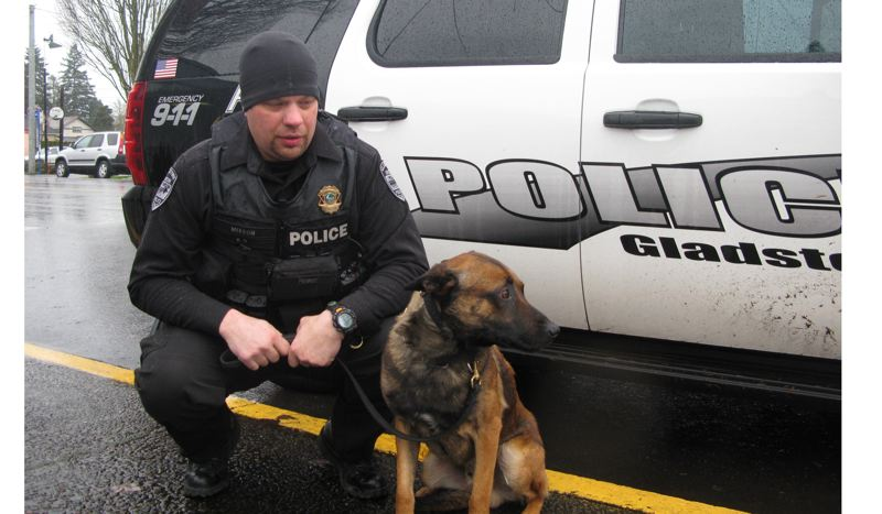 by: FILE PHOTO: RAYMOND RENDLEMAN - Dino is pictured with Officer Steve Mixson soon after joining the Gladstone Police Department in late 2011.