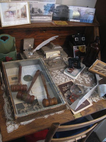 by: PHOTO BY: RAYMOND RENDLEMAN - A writing desk at the entry of the Milwaukie Museum holds a variety of artifacts from the city that goes back to the beginning of Oregon's pioneer history.