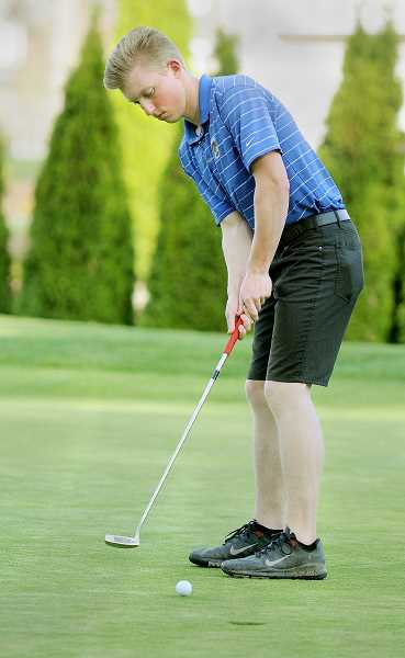 by: SETH GORDON - Going low -- Newberg senior Nolan DeHaven placed fifth individually Monday at the Pacific Conference meet by carding a season-low 78 at Chehalem Glenn Golf Course.