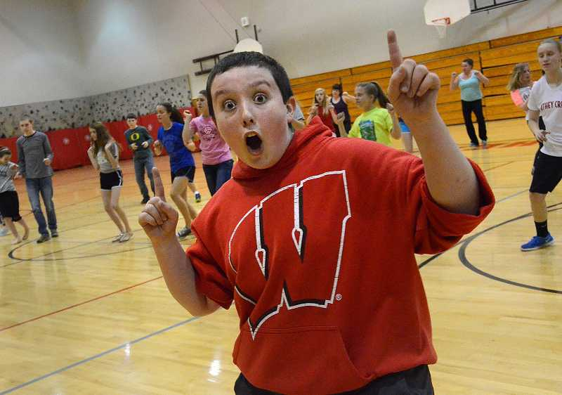 by: TIDINGS PHOTO: VERN UYETAKE - Seventh-grader Aiden Anderson gets into the spirit of the event at Athey Creek Natural Helpers zumba dance party.