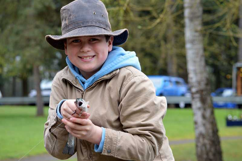by: RICK SWART/ODFW - Zane Nilssen caught his first fish ever last week at ODFW's family fishing event in Canby. The action moves to Molalla this week when ODFW teams up with the Association of NW Steelheaders to host another free family fishing event at Shorty's Pond.