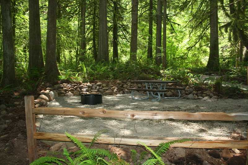 by: BILL TAYLOR - A campsite at Cedar Grove Recreation Site in the Molalla Corridor, with finished trails leading through the woods and down to beautiful fishing and swimming holes on the river.