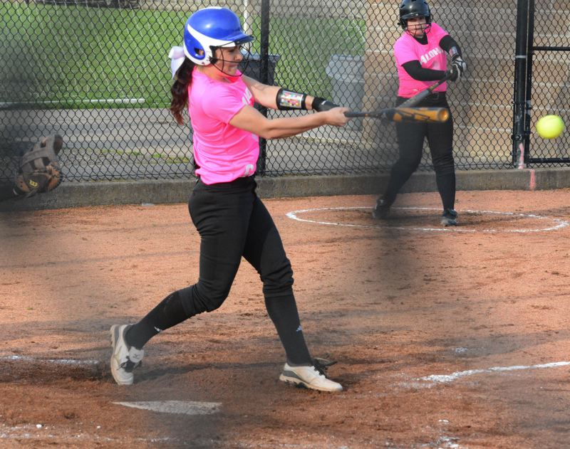 by: TIMES PHOTO: MATT SINGLEDECKER - Aloha senior shortstop Michelle Silva drove in three runs for the Warriors against The Dalles.