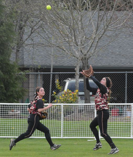 by: TIMES PHOTO: MATT SINGLEDECKER - Southridge outfielder Matlyn Miller camps under a fly ball in center field against West Linn on Friday.