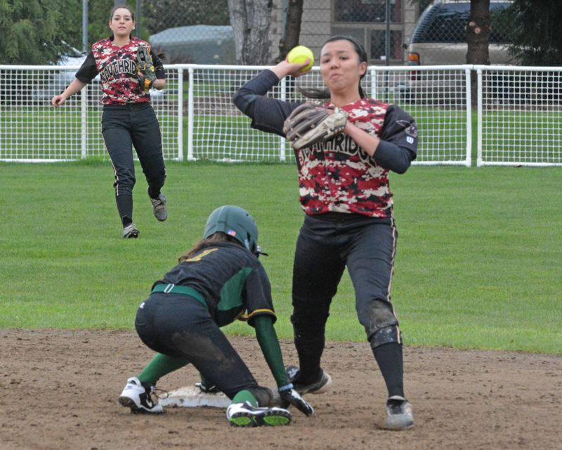 by: TIMES PHOTO: MATT SINGLEDECKER - Southridge senior second baseman Kylie Kushiyama tries to turn a double play versus West Linn.
