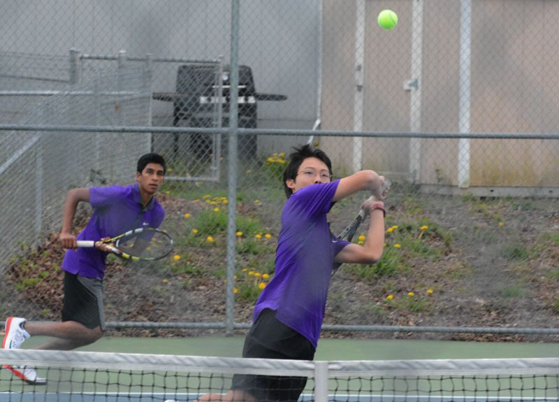 by: TIMES PHOTO: MATT SINGLEDECKER - Sunset junior Ryan Chin and Rahul Bilakanti dropped their first set of doubles action to Westview, but won the second and third sets, 6-0, 6-2.