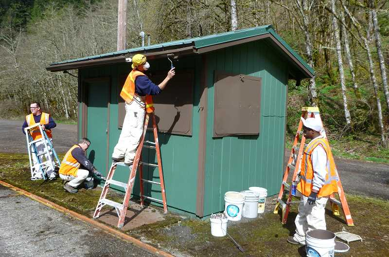 by: CONTRIBUTED - Timber Lake Job Corps painting students clean up  a Weigh Station in the Mt. Hood National Forest.