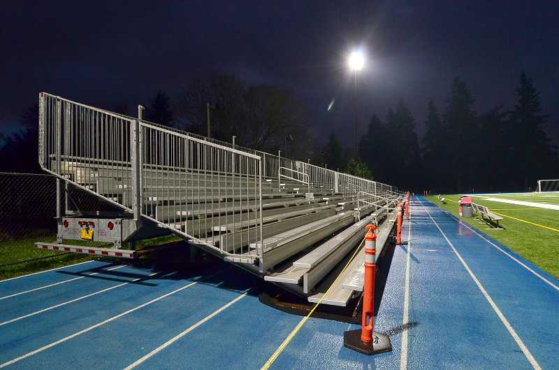 by: REVIEW FILE PHOTO: VERN UYETAKE - Lakeridge currently hauls in temporary bleachers to accommodate visitors because not all fans fit in the permanent stadium seating.
