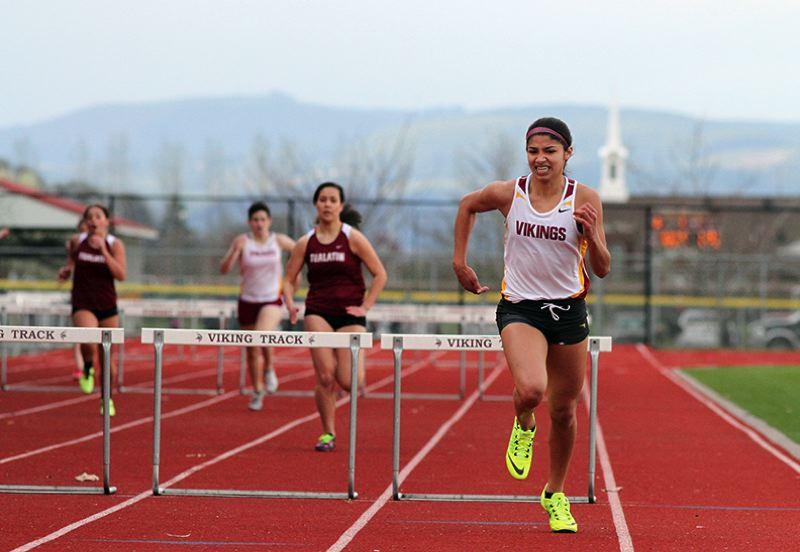 by: NEWS-TIMES PHOTO: AMANDA MILES - Forest Grove sophomore Alyssa Villalobos races to victory in the 300-meter hurdles at last Wednesday's Pacific Conference dual meet against Tualatin. Villalobos won in 50.26 seconds.