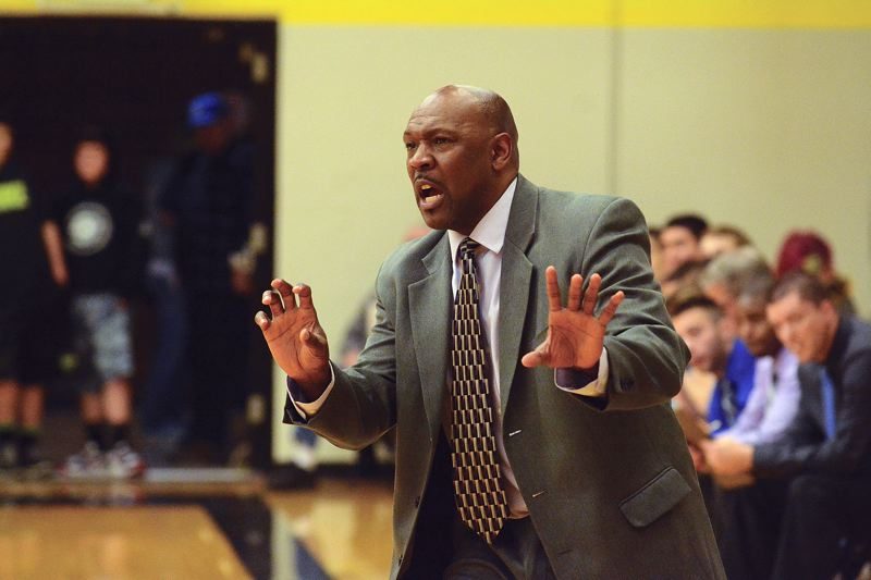 by: JOHN WILLIAM HOWARD - St. Helens head boys' basketball coach Jerry Allen reacts during the Lions' loss to Liberty on Jan 14 in the NWOC opener. Allen won't return as the coach next winter, according to athletic department sources.
