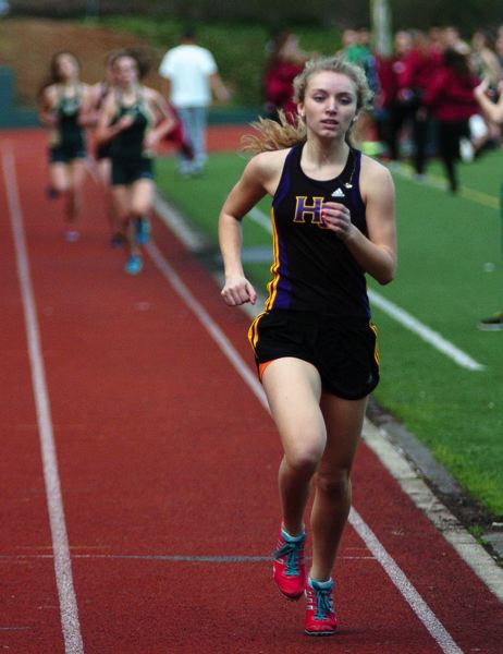 by: DAN BROOD - BACK AND RUNNING STRONG -- Hannah Cesario, shown here in a meet from the 2013 season, is back for the Hawks this year.