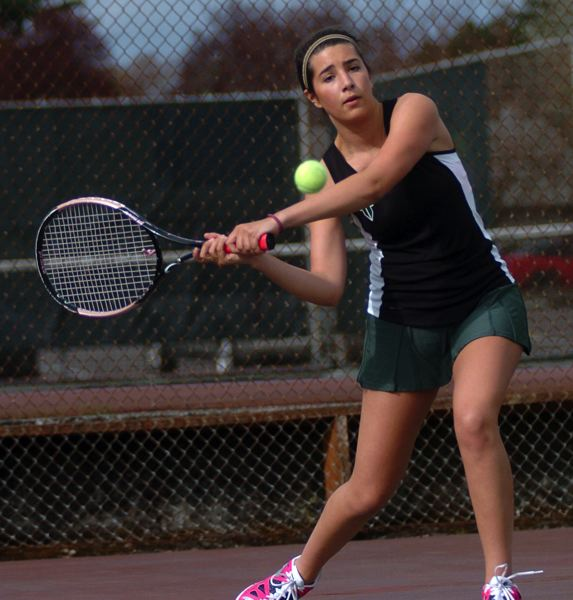 by: DAN BROOD - CLOSE ONE -- Tigard High School senior Fotini Dorrance hits a shot during her 6-3, 5-7, 6-3 win in No. 2 singles play.