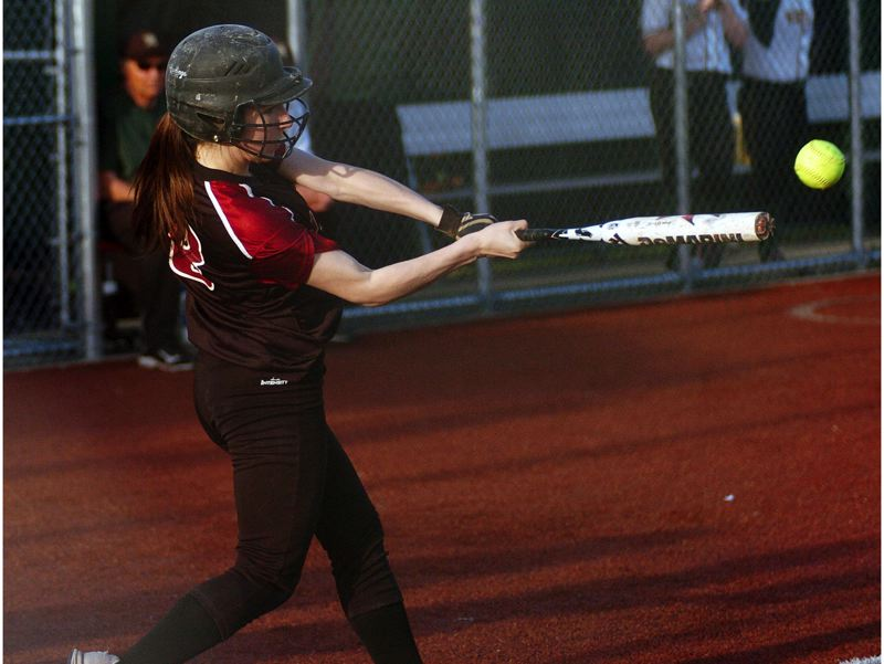 by: DAN BROOD - TIMBERWOLF THUMP -- Tualatin junior Joslyn Gastiaburu gets her bat on the ball for a first-inning RBI single in the Wolves' win at West Linn.