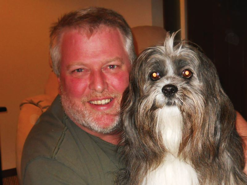 by: CONTRIBUTED PHOTO - Roger Erickson and Sir Bentley, a Lhasa Apso, won the 2013 pet look-alike photo contest.