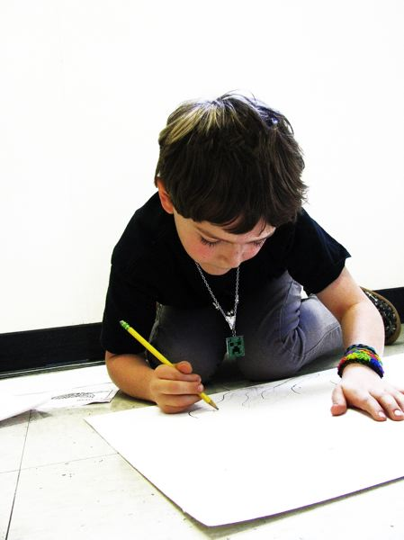 by: OUTLOOK PHOTO: LISA K. ANDERSON - Kyler Cox says he loves art and has enjoyed learning how to draw jaguars in his class jungle unit.