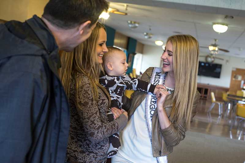by: TIMES PHOTO: JONATHAN HOUSE - Miss Oregon Emma Pelett chats with resident Hope and her son Brodee at the new LifeChange Center for Women and Their Children in Beaverton on Friday as Pastor Rob Howells looks on.