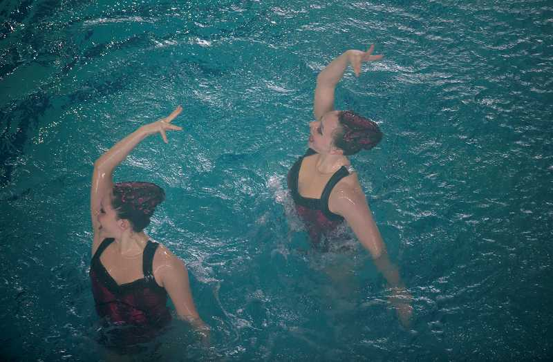 by: TIMES PHOTO: JONATHAN HOUSE - Cecilia Diaz and Lucia Quintela perform with flair during the Senior Free Duet at the OASS Championships in Beaverton on Saturday.