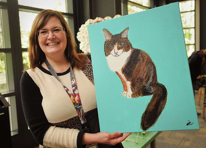 by: TIDINGS PHOTOS: VERN UYETAKE - Library assistant Joanna Campa painted her cat, Quinn, whom she adopted as a rescue cat three years ago.