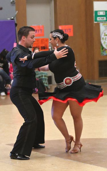 by: PHOTO COURTESY: BRAD CANTOR - Arthur Murray dancers, Shannon and Tom, performing a Salsa.