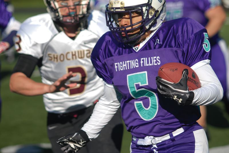 by: PAMPLIN MEDIA GROUP: DAVID BALL - Fighting Fillies running back Latasha Mitchell finds open ground during Saturdays 20-14 home loss to the Portland Shockwave.
