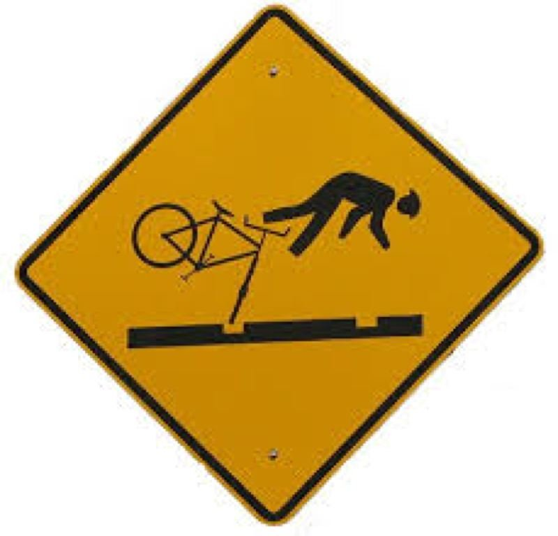 by: CITY OF PORTLAND - Warning signs like these haven't stopped all bicycle accidents on Portland Streetcar tracks.