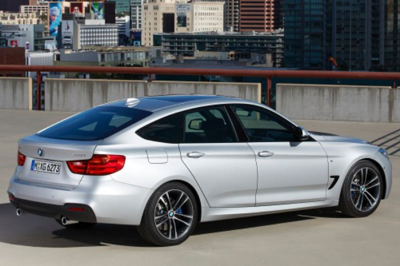 by: BMW NORTH AMERICA - The fastback 2014 328i xDrive GT is actually a sporty hatchback with a tremendous amount of cargo space.