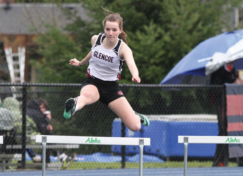 by: HILLSBORO TRIBUNE PHOTO: AMANDA MILES - Glencoe junior Leah McClain sails over a hurdle last Saturday at the Aloha Preview. McClain finished third in the 300-meter low hurdles with a time of 49.43 seconds.