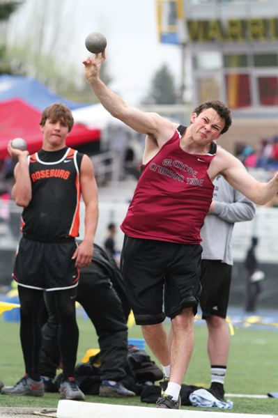 by: HILLSBORO TRIBUNE PHOTO: AMANDA MILES - Glencoe junior Justin Worthy uncorks a throw of 48 feet, 11 and 3/4 inches on his way to a first-place finish in the boys shot put last Saturday.