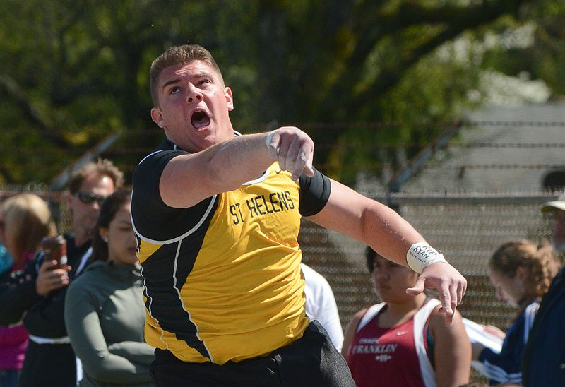 by: JOHN WILLIAM HOWARD - Lion senior Jacob Zartman lets out a yell during shot put competition at the Lower Columbia Invitational. Zartman threw a career-best 49 feet, three inches to win the shot put event.