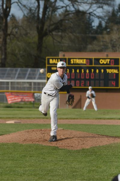 by: JOHN WILLIAM HOWARD - St. Helens Sophomore Quintin Galvin throws out a pitch in the top of the seventh inning. Galvin allowed only four hits in the Lions' victory over Parkrose.