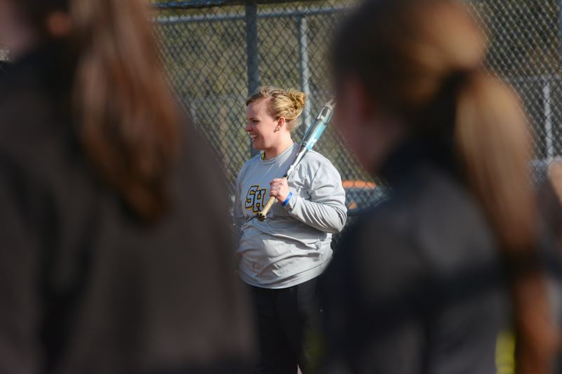 by: JOHN WILLIAM HOWARD - Miranda Little stands at home plate during practice just before preseason play began. Little will assume the head coaching duties following the resignation of former head coach Jeff Edwards.