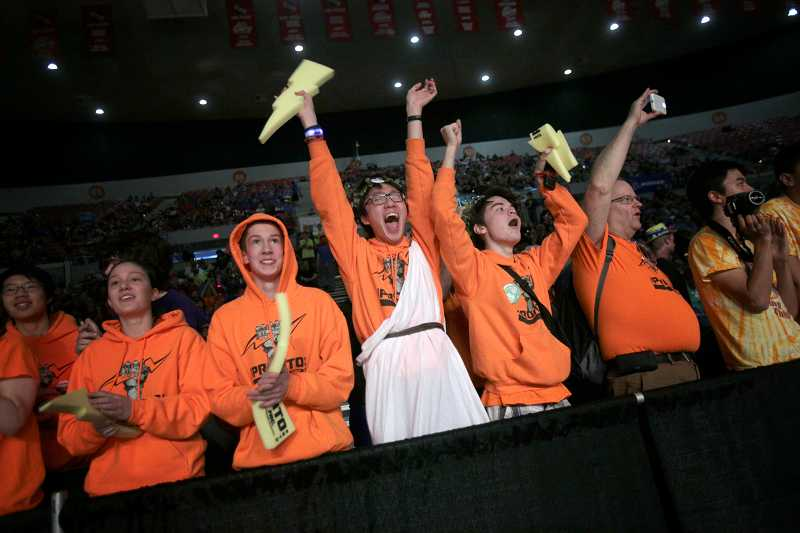 by: TIMES PHOTO: JONATHAN HOUSE - The cheering section for Team Pronto out of Shoreline, Wash., screams for its robot at the Pacific Northwest FIRST Robotics District Championship at Memorial Coliseum.