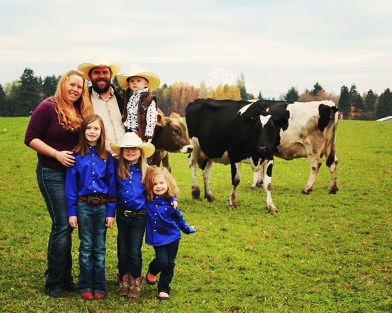 by: CONTRIBUTED PHOTO: MELISSA COLLMAN - Melissa and Andy Collman, holding son William, and with daughters, from left, Elizabeth, Autumn and Hailey, at Cloud-Cap, their organic dairy farm near Boring.