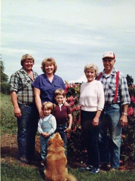 by: CONTRIBUTED PHOTO: MELISSA COLLMAN - Melissa Collman as a toddler with her brother Nick with their parents Gary and Connie Moore, left, and grandparents Arnold Jr. and Jean Moore.