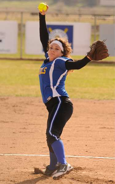 by: LON AUSTIN/CENTRAL OREGONIAN - Pitcher Emily Benton earned a win and a save as the Cowgirls took a pair of games from the Estacada Rangers on Friday.
