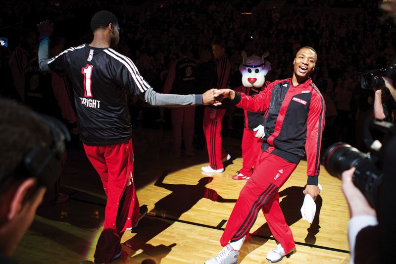 by: TRIBUNE PHOTO: JAIME VALDEZ - Blazers guard Damian Lillard, right, goes through his lineup routine with teammate Blazers forward Dorell Wright.