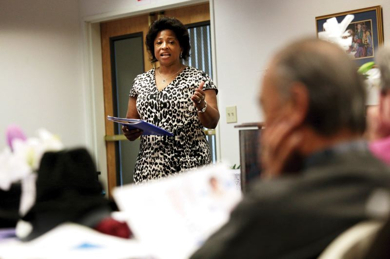 by: TRIBUNE PHOTO: JONATHAN HOUSE - Portland businesswoman Sharon Maxwell speaks at an East Side Democratic Club meeting. She is running against City Commissioner Mick Fish.