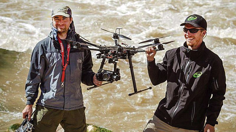 by: COURTESY AERIAL TECHNOLOGIES INTERNATIONAL  - ATI co-founders Lawrence Dennis (right) and Stephen Burtt with an S800 drone on an Idaho rafting trip.