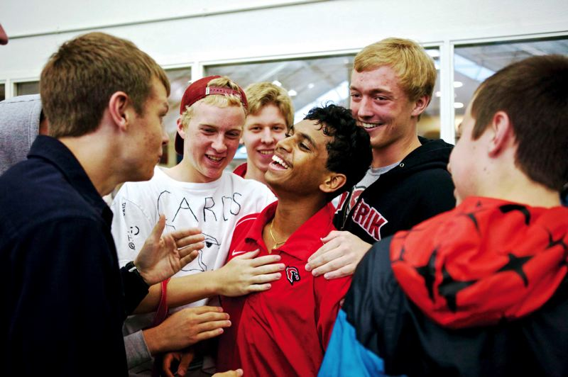 by: TRIBUNE FILE PHOTO: JAIME VALDEZ - Lincoln High's Goutham Sundaram enjoys his 2013 Class 6A singles championship victory with Cardinals teammates at Tualatin Hills Tennis Center.