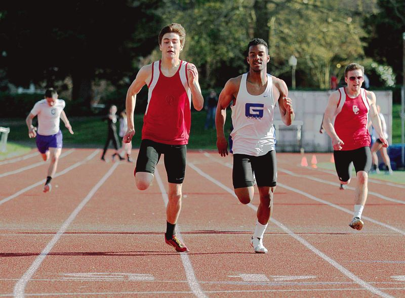 by: TRIBUNE PHOTO: JONATHAN HOUSE - Grant junior Jovon Lewis (right) battles Oregon City senior Alex Canchola down the stretch of the 400 meters at a dual meet last week at Grant. Lewis won in 53.32, with Canchola clocked in 53.33.