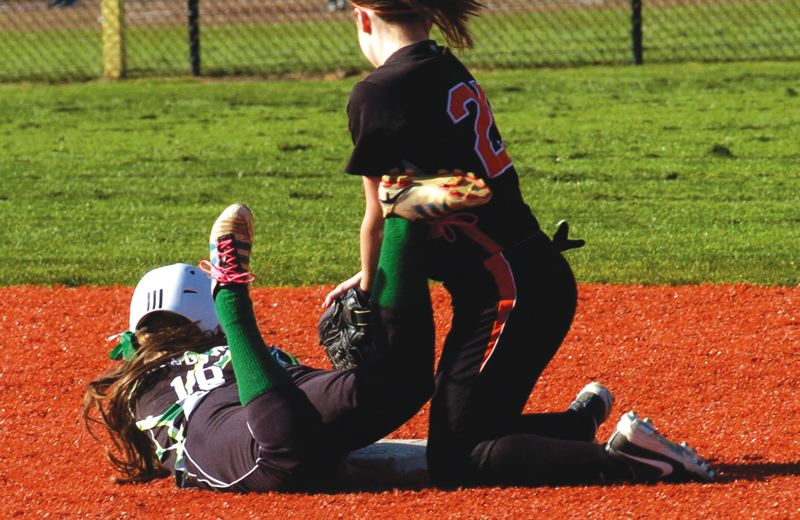 by: ESTACADA NEWS: PARKER LEE - Estacadas Kaylee Schaffer slides in safely at second base during last weeks home loss to Molalla.