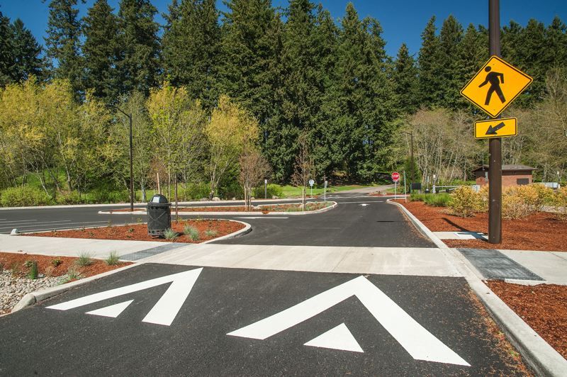 by: SPOKESMAN PHOTO: JOSH KULLA - Improved parking circulation is a big part of the recent overhaul of Memorial Parks parking area. The $883,000 project was carried out by Jeff Kersey Construction of Canby.