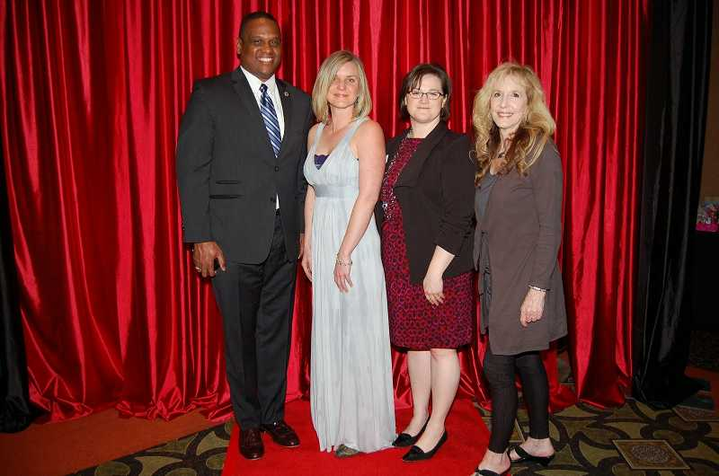 by: SUBMITTED PHOTO - From left, National PTA President Otha Thornton, Lowrie PTA President Chelsea Martin, Oregon PTA President Susan Hamann and Oregon PTA Vice President for Leadership Betty Reynolds celebrate at the Oregon PTA conference April 4.